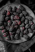 Blackberries on a dark plate