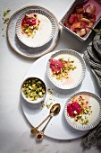 Panna cotta topped with roasted rhubarb and chopped pistachios