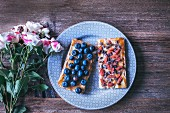 Crispy rye bread toasts with tahini, honey, blueberries, goji berries and cacao nibs