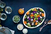 Kale and wild rice salad with carrot, radishes and blood orange vinaigrette