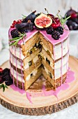 Rustic drip cake with fresh fruit sliced