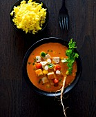 Tofu and vegetable curry with turmeric rice