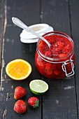 Homemade strawberry jam with orange and lime