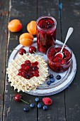 Homemade berry jam with apricots and cherries
