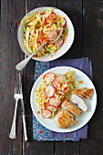 Grilled chicken breast with carrot and radish coleslaw