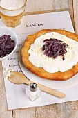 Langos (yeast flat bread, Hungary) with sour cream, feta and onion jam