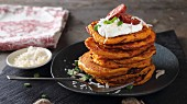 Pumpkin pancakes with sour cream and sausages