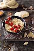 Red lentil houmous with grilled tomatoes and flatbread