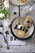 Gluten-free pancakes with coconut flakes and blueberries