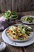 Farfalle with avocado and spinach pesto and fried asparagus