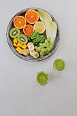Green smoothies and ingredients on a white background (seen from above)