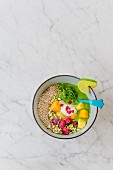 A wild herb smoothie bowl with popped amaranth and frozen fruits