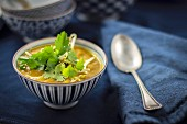 Asian soup with bean sprouts and coriander