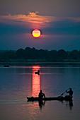 Fishing boats at sunset, Brazil