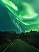 Aurora borealis over a road