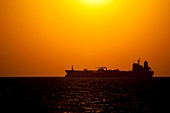 Oil tanker at sunset, Gulf of Mexico