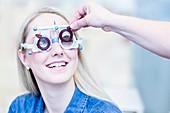 Optometrist examining woman's vision