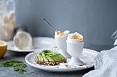 Soft boiled eggs and toast with avocado