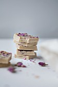 White chocolate with dried rose petals, cashew nuts, organic cocoa butter, honey, and vanilla