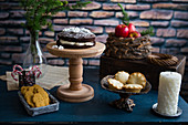A cake, mince pies and biscuits on a festively set table for Christmas