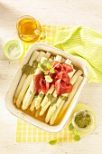 Oven-baked asparagus with pesto, lemon balm and bresaola