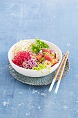 A Poke bowl with sprouts and tuna