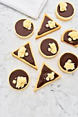 Circle and triangle shaped chocolate tarts