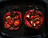 Stuffed peppers on a baking tray