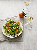 A mixed leaf salad with oranges