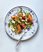 A summer salad with grilled halloumi, peaches and rocket