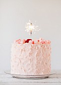 Turkish Delight layer cake with a sparkler candle