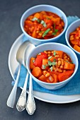 Vegetarian goulash with pumpkin, carrot, red pepper, beans and tomatoes
