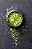 Matcha powder in a stone bowl