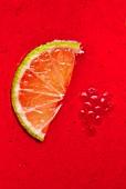 Half a slice of lime and raspberries in lemon and raspberry jelly (full frame)