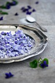 Candied violets on a silver tray