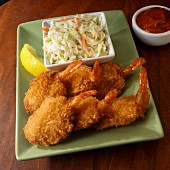 Six fryed shrimp with cole slaw and seafood sauce
