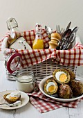 Falafel Scotch eggs with yoghurt sauce for a picnic