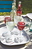 Drinks in stemmed glasses with name tags