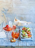 Rosé with rosemary and peach and a Papaya Freezer served with crostini with ham and melon tartare, courgette rolls with ricotta and smoked salmon and a rocket frittata with tomatoes