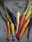 Different coloured pan-roasted carrots
