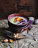 Oriental-style blue potato soup with turmeric espuma