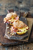 A sesame bagel with BBQ meat and mountain cheese