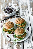 Burgers with spelt patties, herb mayo, spinach, cucumber, and cress