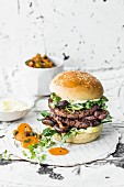 A double burger with beef, shiitake mushrooms, rocket and wasabi mayo
