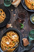 Pasta al Pomodoro (noodles with tomato sauce, Italy) with wine and bread