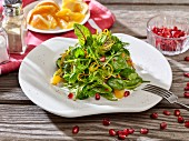 Wild herb salad with oranges and pomegranate seeds