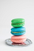 Homemade colourful French macarons with lemon curd