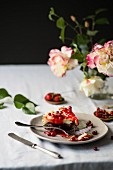 Cheese cake with red fruits over the table