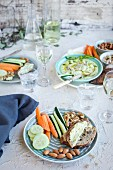 Meyer Lemon Basil Hummus served with vegetables, bread and white wine