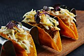 Taco shells with fish and vegetables